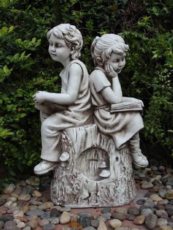 Boy And Girl Reading On Stump